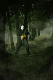 Masked mad man. In the woods . Halloween and horror concept stock photography