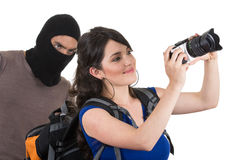 Masked male thief robbing beautiful young girl Stock Photography