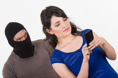Masked male thief robbing beautiful young girl Royalty Free Stock Image