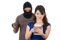 Masked male thief robbing beautiful young girl Royalty Free Stock Photo