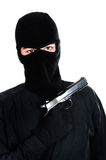 Masked man aims with gun Stock Photos