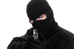 Masked man aims with gun. Selective focus Royalty Free Stock Photography