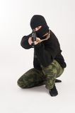Masked man aims with rifle Royalty Free Stock Photos