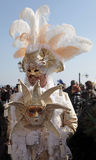 Masked man in costume on San Marco Square during the Carnival in Stock Photo