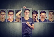Masked man expressing different emotions. Masked young man expressing different emotions royalty free stock images