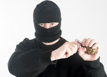 Masked man with grenade Royalty Free Stock Images