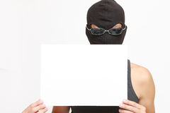 Masked man with a message board. Concept shot of climb ans justice Stock Photo