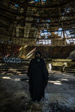 Masked man in ruins Stock Photos