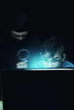 Masked man spying data from notebook Stock Image