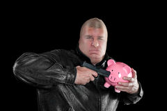 Masked man stealing piggybank Royalty Free Stock Photo