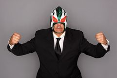 Masked man in a suit stock image