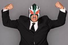 Masked man in a suit royalty free stock images