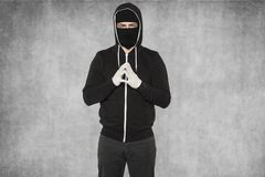 Masked man is very calm. Wearing black cloths Royalty Free Stock Photos