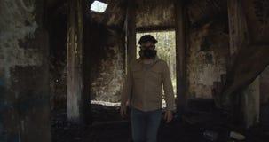 A masked man walks through an infected building. the harsh surroundings. radioactive ruins. Chernobyl, Pripyat.