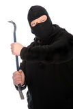 Masked man wielding a crowbar. Dangerous masked man wielding a crowbar intent on robbery, housebreaking, hooliganism or causing bodily harm isolated on white Stock Photos