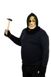 Masked maniac brandishing a hammer. Black masked maniac brandishing a hammer on white background Royalty Free Stock Photo