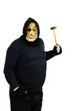Masked maniac waving a hammer. Fat black masked maniac waving a hammer on white background Royalty Free Stock Photos