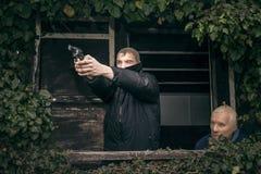 Masked men with a gun Royalty Free Stock Photos