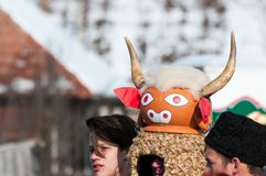 Masked men portrait on the winter ending Transylvanian traditional carnival. Crowd Stock Image