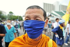 Masked Monk. A masked Buddhist monk attends an anti-government rally organised by the nationalist Pitak Siam group on November 24, 2012 in Bangkok, Thailand Stock Photo