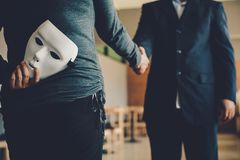 Masked, no sincerity of doing business together.  royalty free stock photography