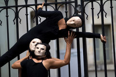 Masked people near a gate. Royalty Free Stock Images