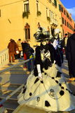 Masked people Venice Carnival. People in black and white Venetian carnival masks and costumes on Carnival Celebration Venice,Italy Royalty Free Stock Images