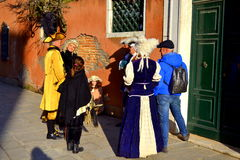 Masked people at Venice  street Stock Photo