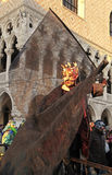 Masked person in costume on San Marco Square near Doges Palace Royalty Free Stock Photography