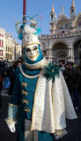 Masked person in costume on San Marco Square, Venice Stock Photo