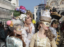 Masked persons in beautiful ornate costume on San Marco Square, Stock Images