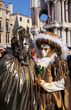 Masked persons in costume on Carnival in Venice, Italy. Royalty Free Stock Photography