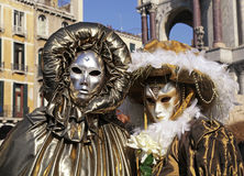 Masked persons in costume on Carnival in Venice, Italy. Royalty Free Stock Photo