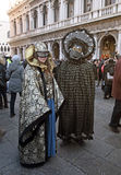 Masked persons in costume on Carnival in Venice Royalty Free Stock Image