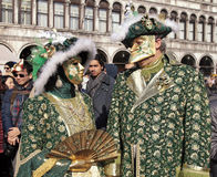 Masked persons in costume on San Marco Square during the Carniva Stock Photo