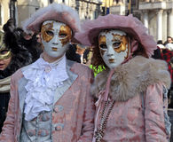 Masked persons in costume on San Marco Square during the Carniva Stock Photography