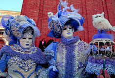 Masked persons in costume on San Marco Square during the Carniva Stock Images