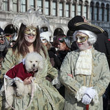 Masked persons in costume on San Marco Square during the Carniva Stock Photos