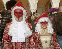 Masked persons in costume on San Marco Square, Carnival in Venic Stock Photos