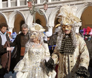 Masked persons in costume on San Marco Square, Venice, Italy. Stock Image