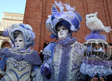 Masked persons in magnificent lilac costume during the Carnival Royalty Free Stock Photography