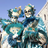Masked persons in magnificent turquoise costume during the Carni Royalty Free Stock Photo