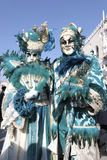 Masked persons in magnificent turquoise costume during the Carni Royalty Free Stock Photos