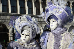 Masked persons in ornate medieval costume on San Marco Square, V Stock Photography