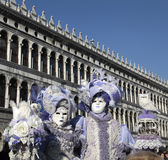 Masked persons in ornate medieval costume on San Marco Square, V Royalty Free Stock Image