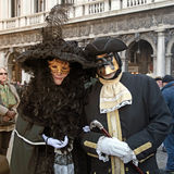 Masked persons on San Marco Square during Carnival in Venice, It Royalty Free Stock Image