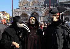 Masked persons in traditional venetian costume on San Marco Squa Stock Photos