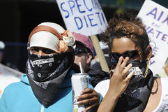 Masked protesters. Stock Images