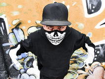Masked rapper. Street portrait of a rapper with a mask Royalty Free Stock Photos