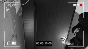 The masked robber c with a knife broke into the apartment. CCTV camera.  Stock Images